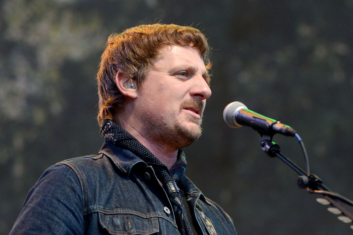 Sturgill Simpson singing into a mic