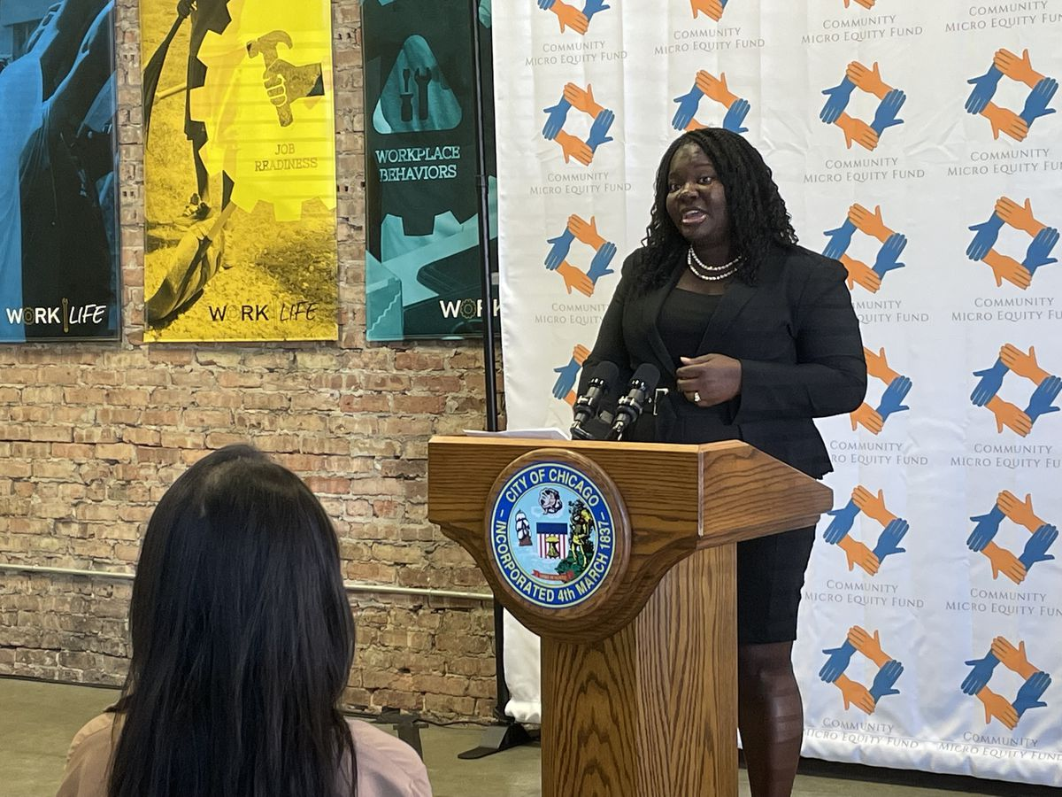 Erica King, the president of Greenwood Archer Capital, during a news conference Wednesday, Sept. 15, 2021, in Chicago's Woodlawn neighborhood provides details about the new Community Micro Equity Fund that is meant to help build wealth for individuals and communities on the South and West sides.