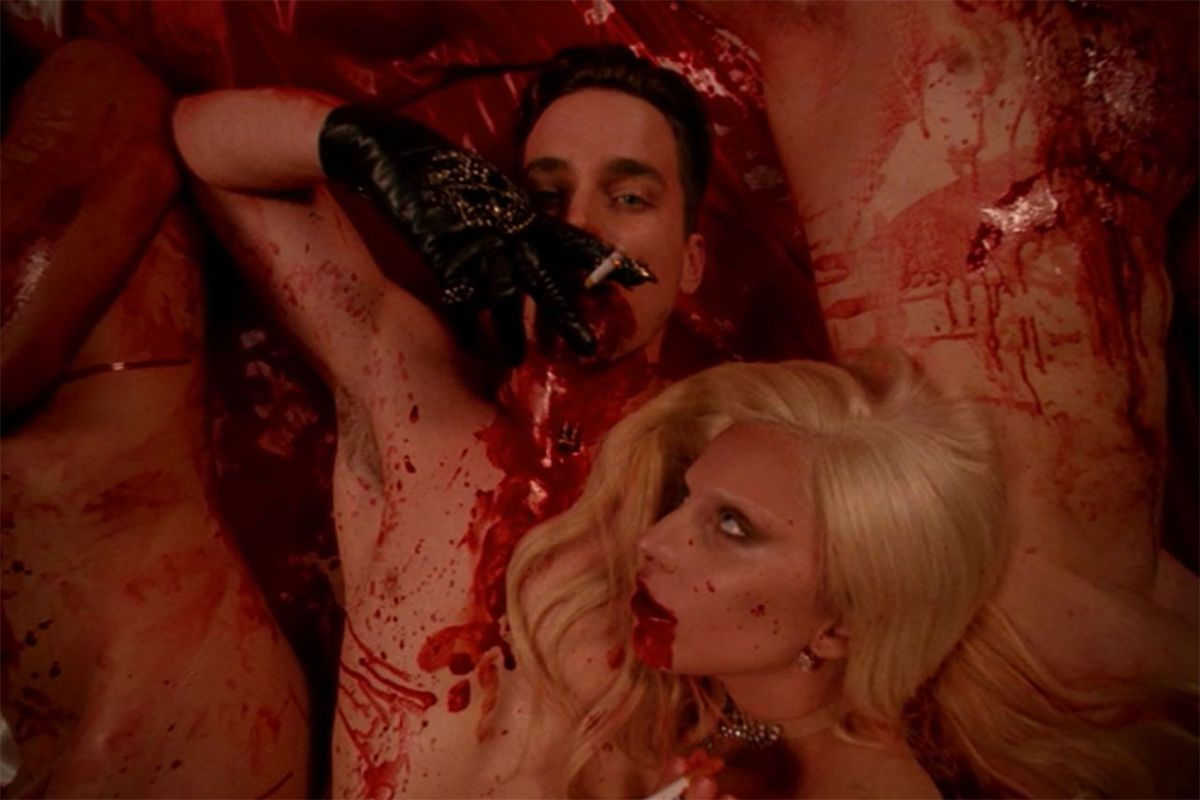 two naked vampires aka the afflicted in a pile of blood in american horror story