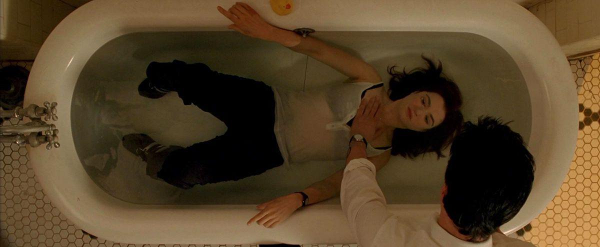 constantine holds angela under water in a bathtub