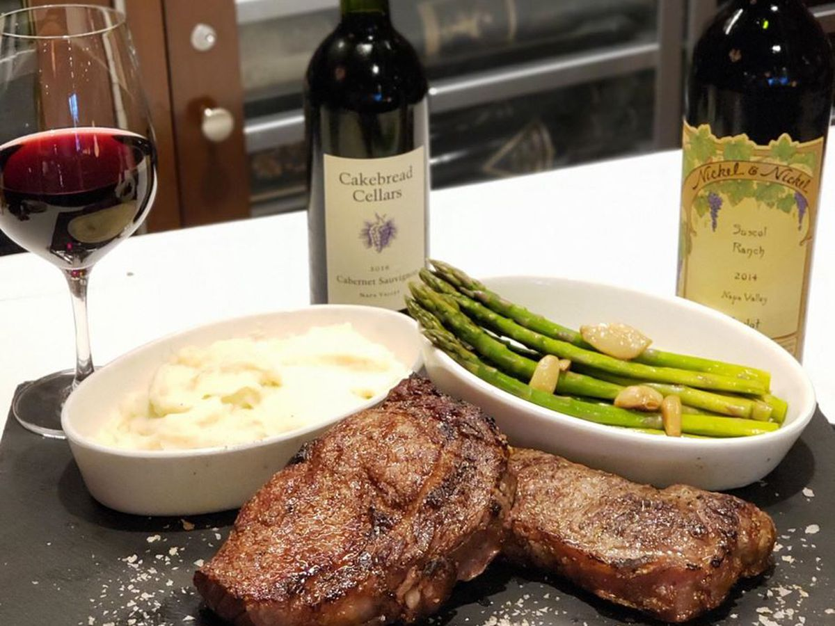 Steak, classic sides and also bottles of wine, all still on the pickup menu at The Palm