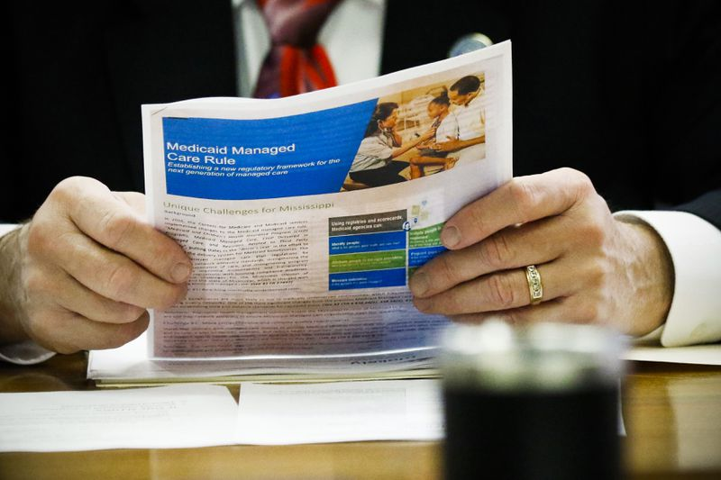 A member of the Senate Medicaid Committee reviews a Medicaid handout that reviews the managed care rule at the Capitol in Jackson, Mississippi, on January 24, 2018.