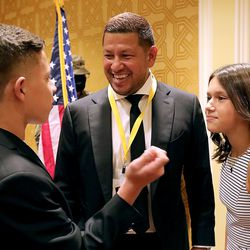 Real Salt Lake goalkeeper Nick Rimando talks to his children Jett and Benny before Rimando is honored at the Utah Sports Hall of Fame banquet at the Little America Hotel in Salt Lake City on Monday, Sept. 20, 2021.