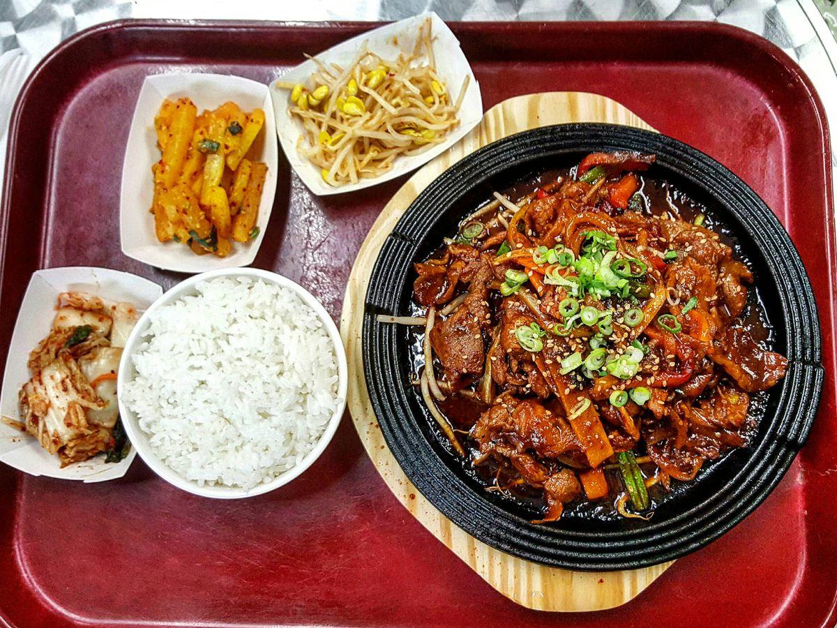 Spicy pork bulgogi and assorted banchan at Reliable Market