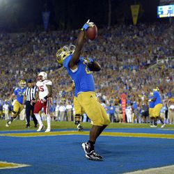 UCLA running back Johnathan Franklin celebrates after scoring a touchdown during the second half of their NCAA football game against Nebraska, Saturday, Sept. 8, 2012, in Pasadena, Calif. UCLA won 36-30.