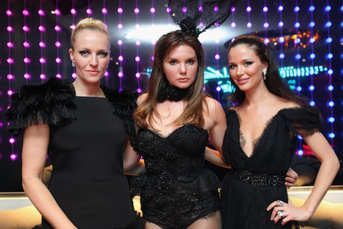 Marchesa designers pose with their new Playboy outfit (Photo: Getty Images)