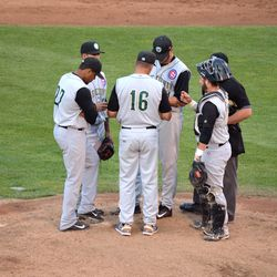 Pitching coach David Rosario (16) meets with Cougars players: pitcher Corbin Hoffner, catcher Ben Carhart, and infielders Jeimer Candelario (27) and Carlos Penalver (behind Candelario)