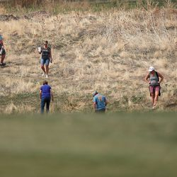Parents look for a ball during the 6A boys state tournament at Davis Park Golf Course in Kaysville on Tuesday, Oct. 5, 2021.