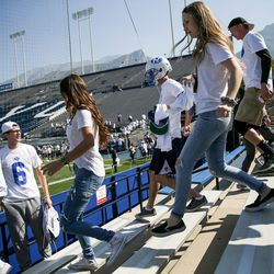 Brigham Young Cougars fans rush to get prime seating in the student section before the game against the Wisconsin Badgers at LaVell Edwards Stadium in Provo on Saturday, Sept. 16, 2017.