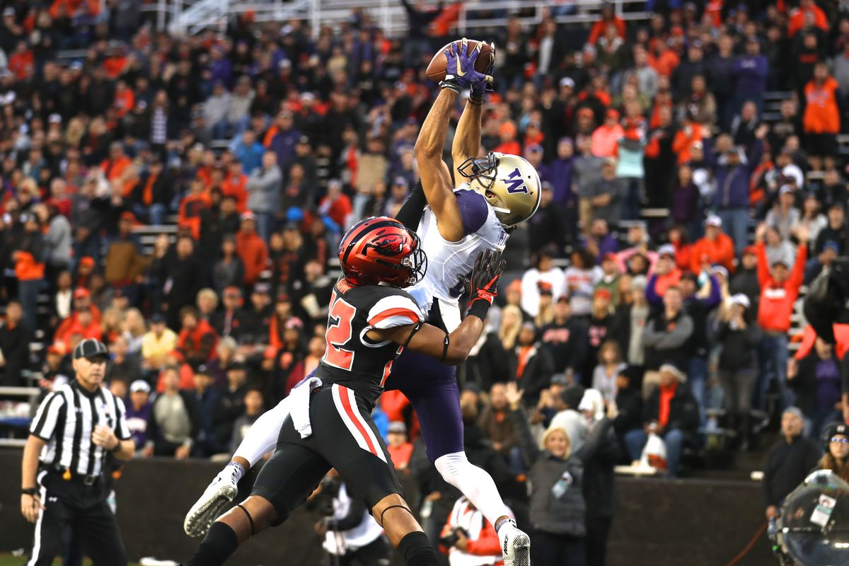 CORVALLIS, OR:  Washington Huskies wide receiver Dante Pettis (8) stretches for a touchdown catch over Oregon State Beavers cornerback Isaiah Dunn (22) at Reser Stadium.