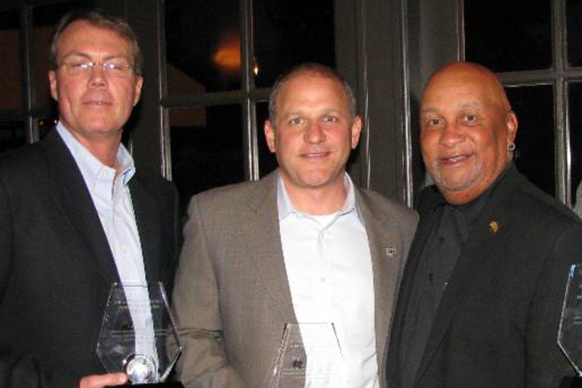Marc Badain (center) accepting an award The Oakland Metropolitan Chamber of Commerce