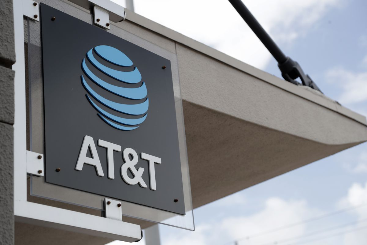 In this July 18, 2019, file photo, a sign is displayed at an AT&T retail store in Miami. Corporations have given more than $50 million in recent years to state lawmakers who have seized on Donald Trump's lies about a stolen 2020 election to push for new restrictions on the right to vote.