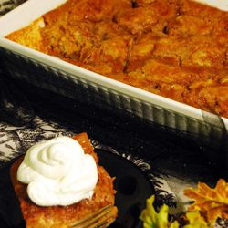 Pumpkin Pie Cake can be topped with whipped cream or ice cream.