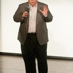 In this March 3, 2010 photo, the Rev. Carl Keyes speaks to an audience in Harrisonburg, Va., about his life experiences relating to his organization, Aid for the World. According to financial records, internal correspondence and interviews with former employees conducted by The Associated Press, Keyes blurred the lines between his charities, his ministry and his personal finances while promoting himself as an international humanitarian.