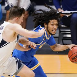 UCLA guard Tyger Campbell (10) drives past BYU guard Connor Harding (44) during the second half of a first-round game in the NCAA college basketball tournament at Hinkle Fieldhouse in Indianapolis, Saturday, March 20, 2021.