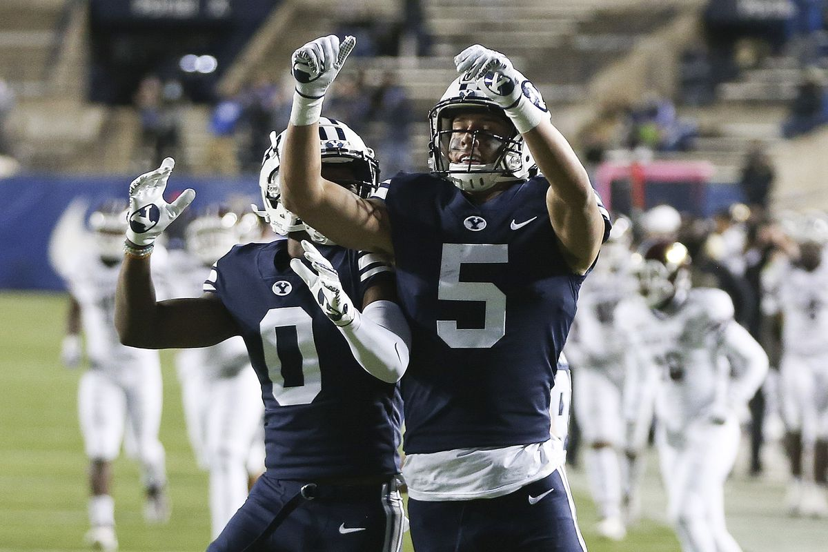 Brigham Young Cougars wide receiver Dax Milne (5) celebrates his touchdown against the Texas State Bobcats with Brigham Young Cougars wide receiver Kody Epps (0) in Provo on Saturday, Oct. 24, 2020.