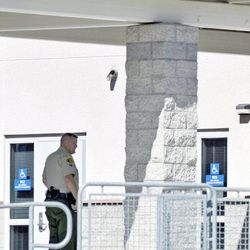 A Los Angeles County sheriff's deputy is stationed at Arroyo Seco Junior High School in the Valencia neighborhood of Santa Clarita, Calif., Tuesday, Sept. 18, 2012.  Eric Yee, accused of posting comments on ESPN's website saying he was watching kids and wouldn't mind killing them, was in jail Tuesday on $1 million bail after he was arrested at his home near the school for investigation of making terrorist threats, authorities said.