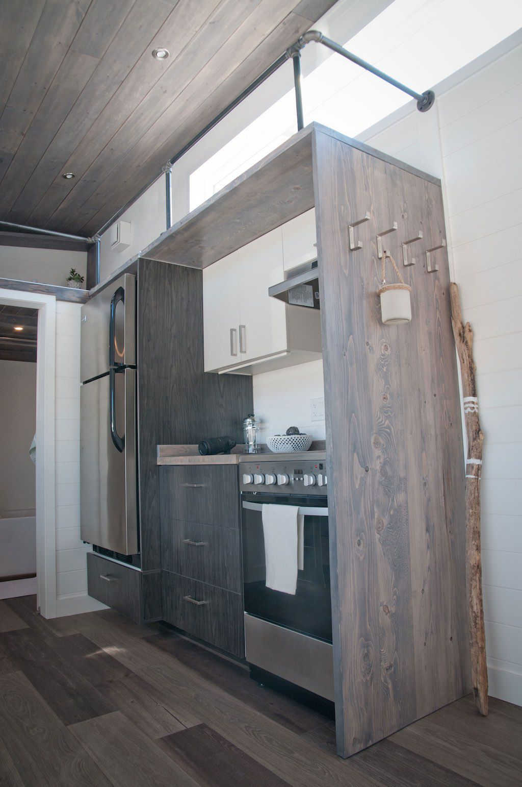 Tiny house with 'bedroom' offers minimalist chic - Curbed on bauhaus home design, modern architecture home design, self-sustaining home design, art deco home design, art nouveau home design, zero energy home design, baroque home design, minimalist home design, ultra modern home design,