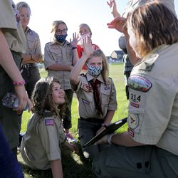 Kaiya Massey, center left, and senior patrol leader Makaylee Carlisle, center right, discuss a video they just watched about hiking strategies, like the rest step to combat fatigue, during a Boy Scout meeting for the all-female Troop 314 at Parkview Park in Stansbury Park on Monday, July 6, 2020.