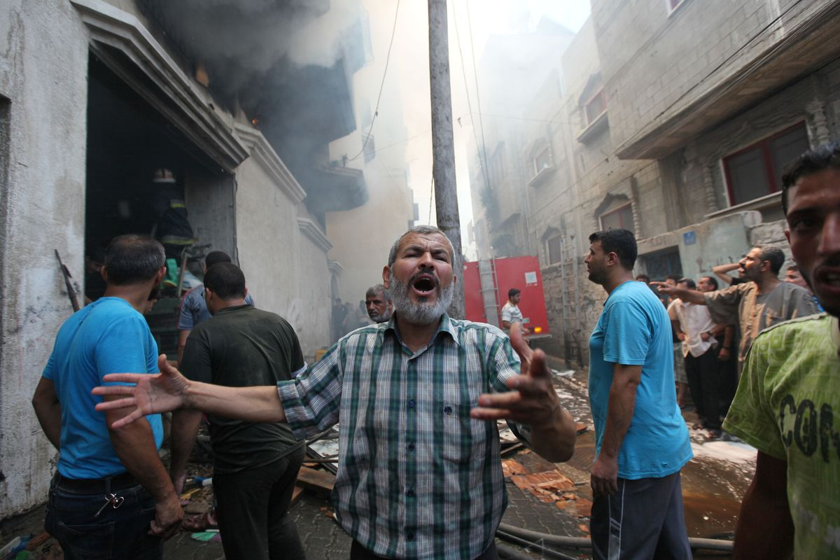 Firefighters at a building fire in Gaza City