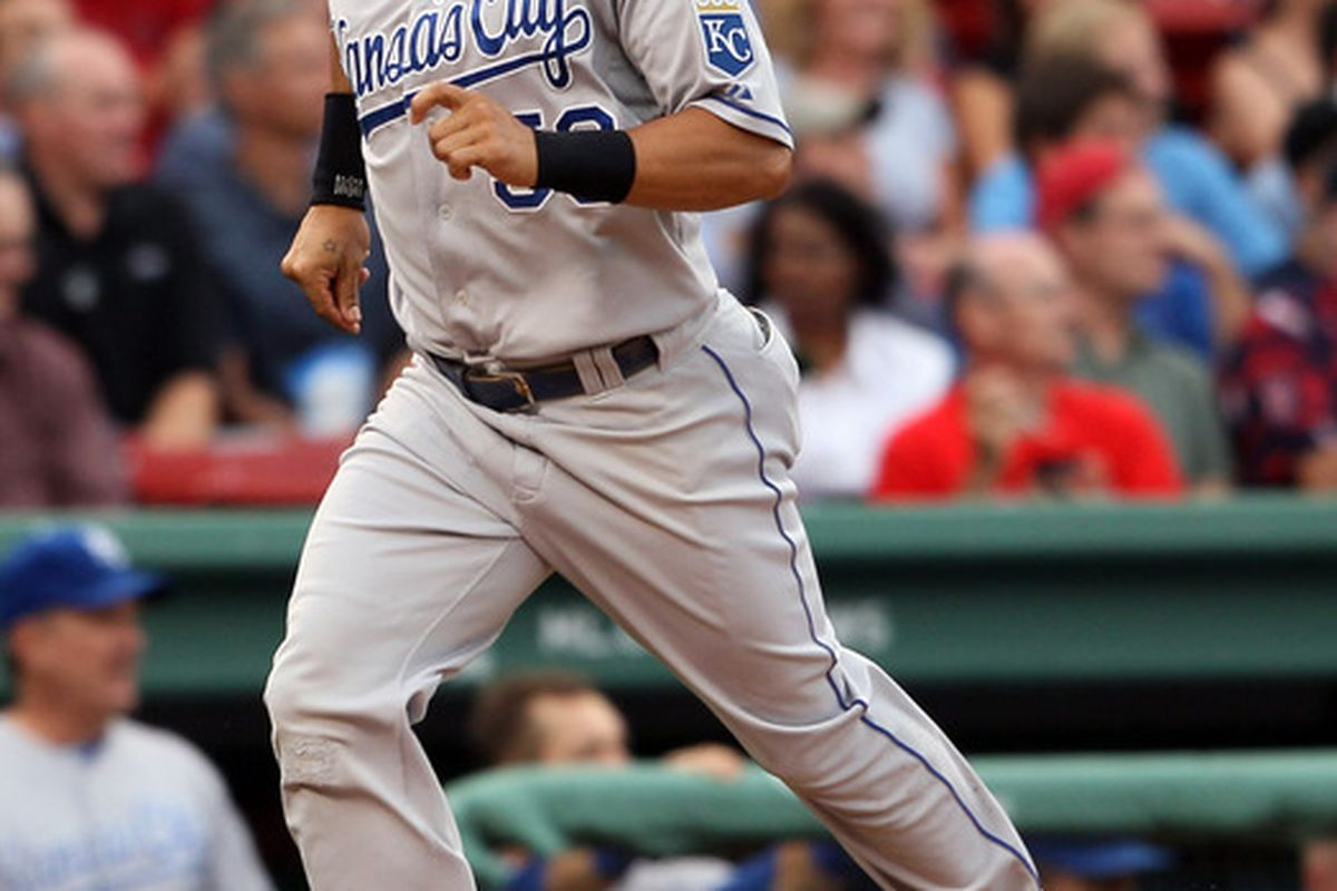 BOSTON, MA - JULY 26: Melky Cabrera #53 of the Kansas City Royals scores in the first inning against the Boston Red Sox on July 26, 2011 at Fenway Park in Boston, Massachusetts.  (Photo by Elsa/Getty Images)