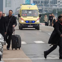 Ambulances arrive to the scene at Brussels airport, after explosions rocked the facility in Brussels, Belgium, Tuesday March 22, 2016. Authorities locked down the Belgian capital on Tuesday after explosions rocked the Brussels airport and subway system, killing at least 34 people and injuring many more. Belgium raised its terror alert to its highest level, diverting arriving planes and trains and ordering people to stay where they were. Airports across Europe tightened security.