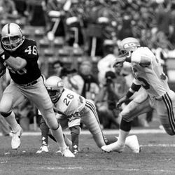In this Oct. 30, 1983 photo provided by the NFL, Los Angeles Raiders tight end Todd Christensen (46) runs with the football after making a catch during a football game against the Seattle Seahawks in Los Angeles. Former Raiders tight end and five-time Pro Bowler Todd Christensen died from complications during liver transplant surgery. He was 57. Christensen's son, Toby Christensen, said his father passed away Wednesday morning, Nov. 13, 2013, at Intermountain Medical Center near his home in Alpine, Utah. (AP Photo/NFL Photos)