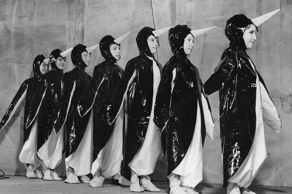 Pantomime for Kids performed by kids, Children wearing penguincostumes on the stage, Photograph, 1936