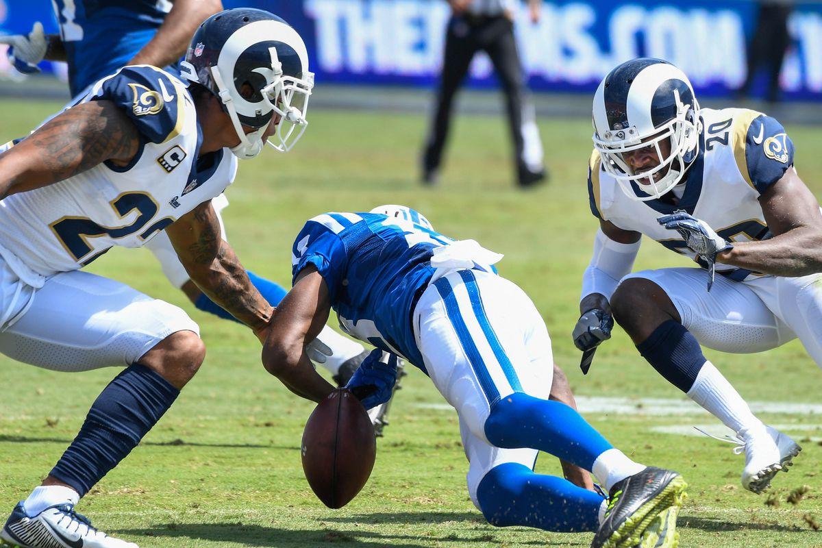 Los Angeles Rams CB Trumaine Johnson (22) and S Lamarcus Joyner (20)converge on Indianapolis Colts WR Kamar Aiken