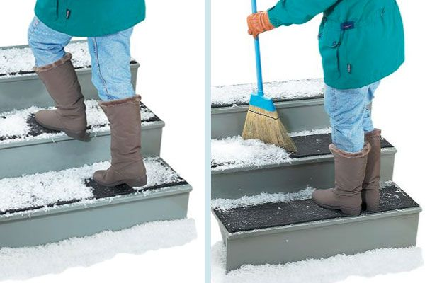 Person sweeping snow of steps and ice breaker stair mat.
