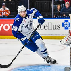 Syracuse Crunch Brady Brassart (19) skates through Belleville Senators Jake Paterson's (35) crease in American Hockey League (AHL) action at the War Memorial Arena in Syracuse, New York on Friday, November 2, 2018. Syracuse won 5-4.