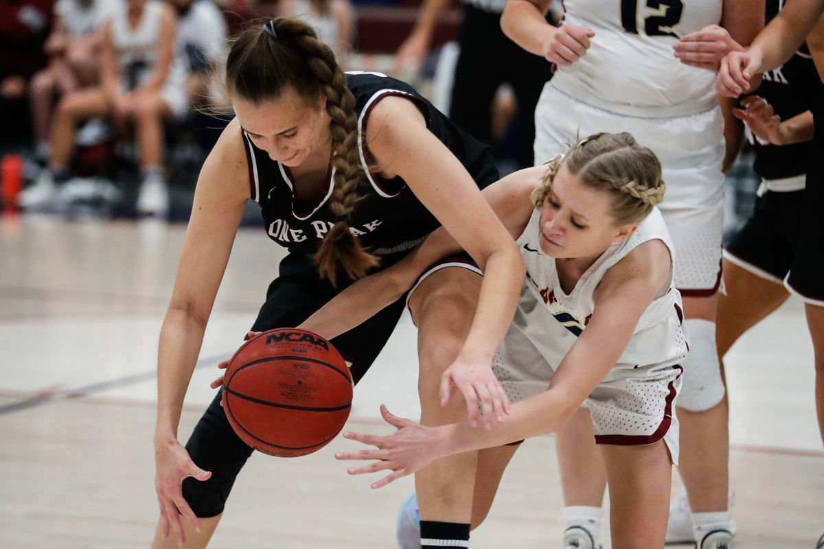 Lone Peak's Maile Hunt (42) battles for a ball against Herriman's Ainzlee Enger (2) in a high school basketball game at Herriman High School in Herriman on Thursday, Dec. 3, 2020.