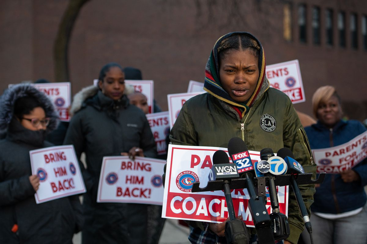 Tainika Somerville, parent of two students who attend Curie High School, speaks to reporters on Friday.