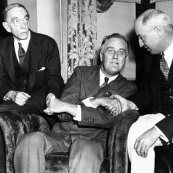 FILE - In this July 2, 1932, file photo, Gov. Franklin D. Roosevelt, Democratic nominee for President, thanks Louis Mc Howe, left, and James Farley, in Chicago, after delivering his acceptance speech before the democratic convention. Democrats have little hope of matching the fervor and historical import of their 2008 convention, when they made Barack Obama the first black presidential nominee of a major political party. One of the memorable moments from past conventions was Roosevelt inventing the tradition of the nominee coming to the convention to accept the nomination with a speech, instead of waiting for a formal ceremony weeks later.