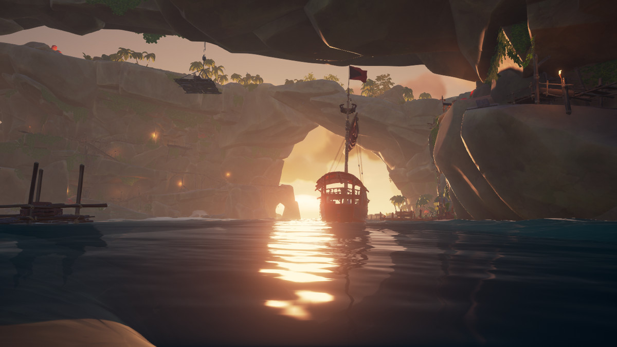 A ship navigates through Thieves' Haven in Sea of Thieves