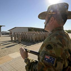 In this photo released by Australian Department of Defence, Regimental Sergeant Major Dale DeKock of 5th Battalion (Mechanised) Royal Australian Regiment is on parade before the United States Marine Corps personnel during the Australian Minister for Defence's official welcome ceremony at Robertson Barracks in Darwin, Australia, Wednesday, April 4, 2012. Approximately 200 Marines of Fox Company, 2nd Battalion, 3rd Marine Regiment, arrived at RAAF Base Darwin to begin the lead up to moving out field and commencing exercises in some of the Australian Defence Force's premier training areas in Northern Australia.