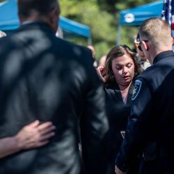 Ashley Lyday, widow of fallen Ogden Nathan Lyday, installs a plaque bearing her husband's name on the Utah Law Enforcement Memorial at the Capitol in Salt Lake City on Thursday, May 6, 2021, during the annual Utah Police Memorial Service.