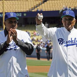 Dodger greats Tommy Davis, left, and Don Newcombe are honored before both threw out ceremonial pitches in a baseball game between the Los Angeles Dodgers and the San Diego Padres in Los Angeles Sunday, April 15, 2012.