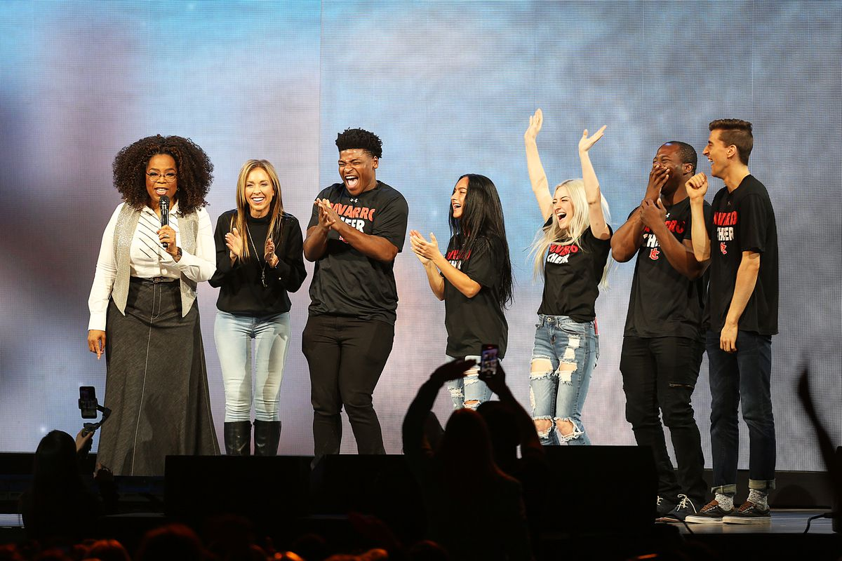 """Oprah Winfrey speaks with the cast of Netflix's """"Cheer"""": Monica Aldama (from left), Jerry Harris, Gabi Butler, Lexi Brumback, TT Barker and Dillon Brandt during Oprah's 2020 Vision: Your Life in Focus Tour in Dallas, Texas."""