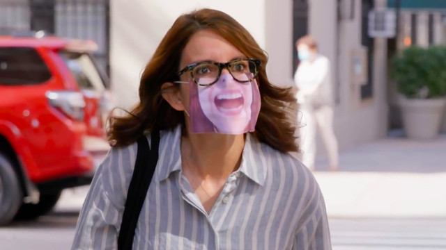Tina Fey as Liz Lemon in the 30 Rock reunion special wearing a mask because of COVID-19 baby