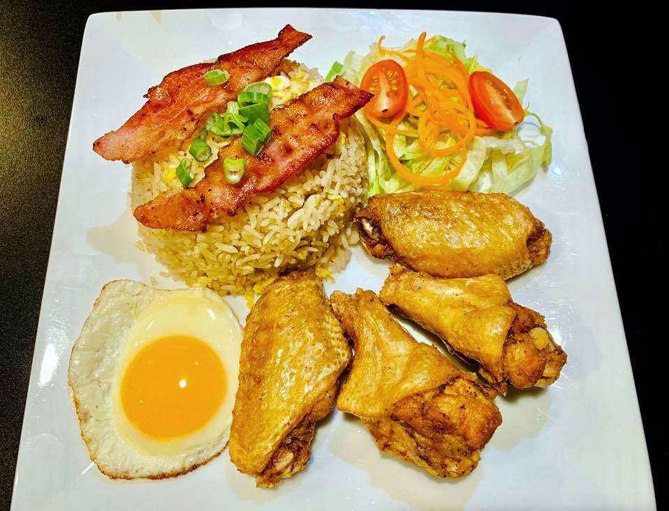 """The """"Happy Family"""" fried rice dish at Chai Tip's Thai & Chinese Foods, featuring bacon, chicken wings and a fried egg."""