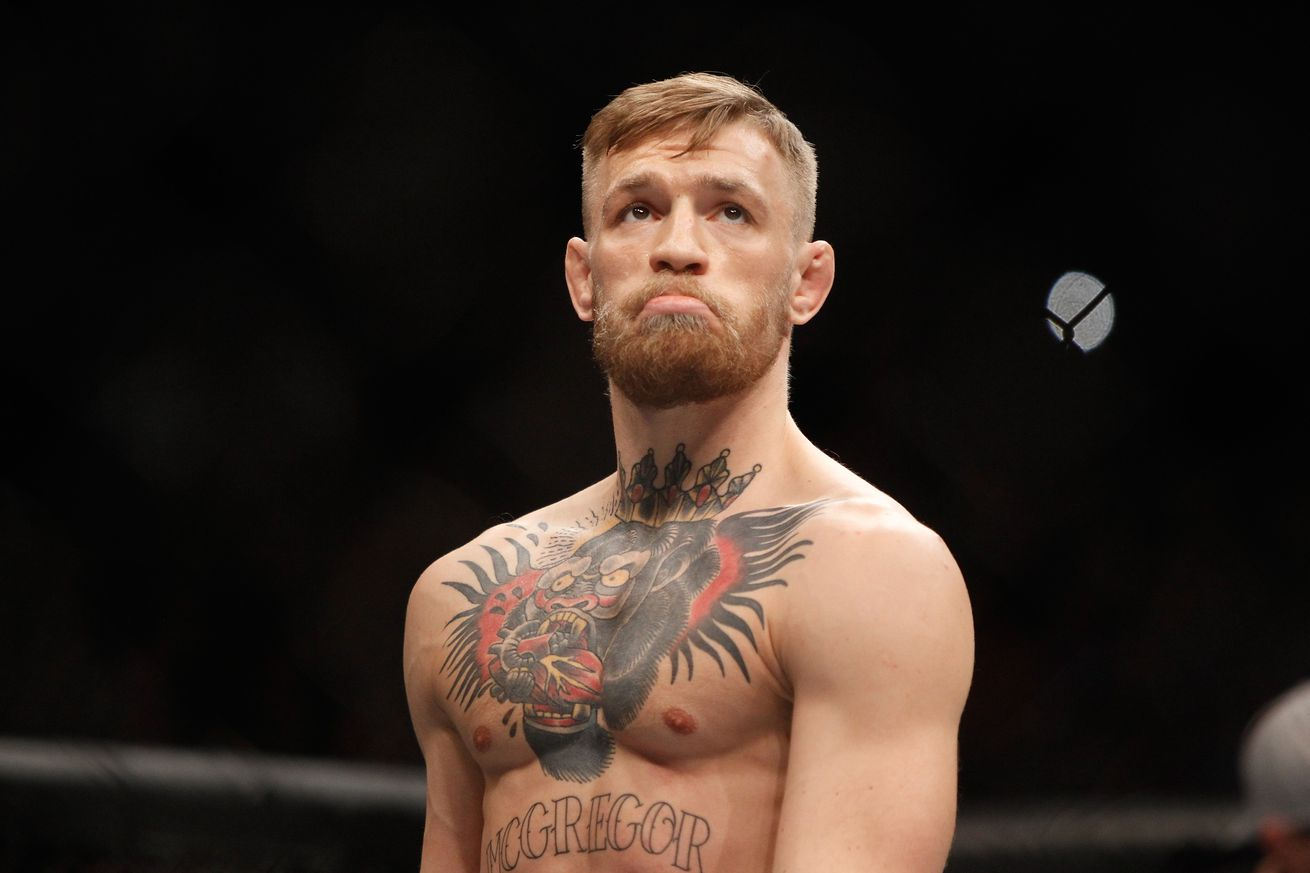 Johnson reveals how Conor McGregor vacated UFC title to box Floyd Mayweather