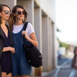 Models outside of the runway shows in Sydney wearing cat eye sunglasses.