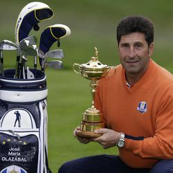 European team captain Jose Maria Olazabal poses with the trophy at the Ryder Cup PGA golf tournament Tuesday, Sept. 25, 2012, at the Medinah Country Club in Medinah, Ill.