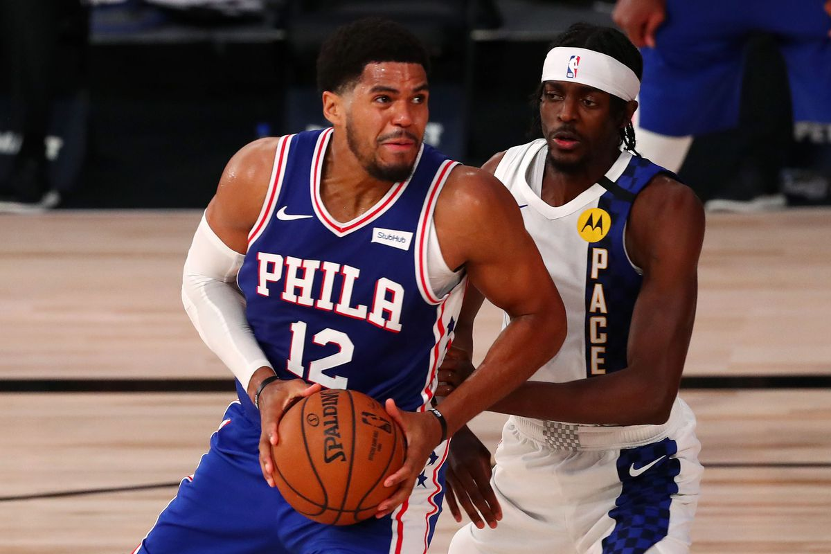 Tobias Harris of the Philadelphia 76ers drives to the basket against Justin Holiday of the Indiana Pacers during the fourth quarter of an NBA basketball game at the Visa Athletic Center in the ESPN Wide World Of Sports Complex on August 1, 2020 in Lake Buena Vista, Florida.