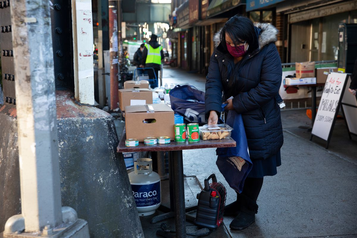 Juli Pineda picks up food at the Masbia Borough Park food pantry for her husband and three children, Feb. 16, 2021.