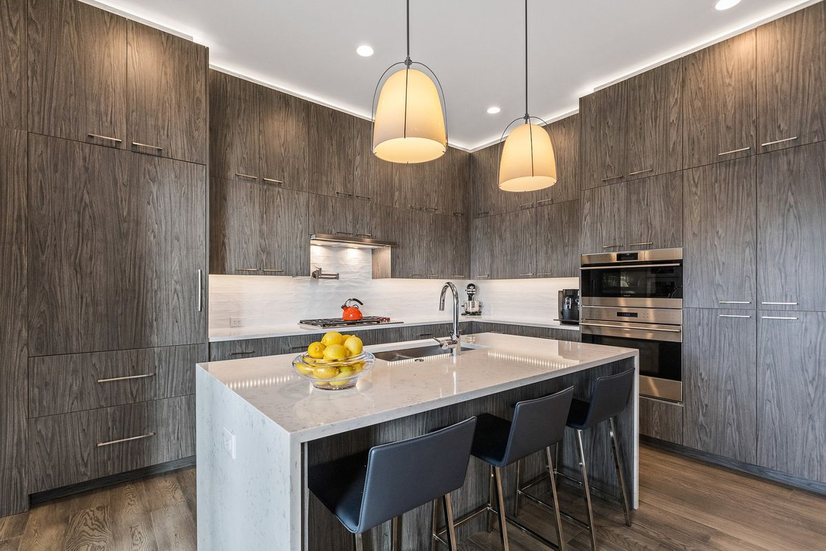 A high end kitchen with modern cabinetry.
