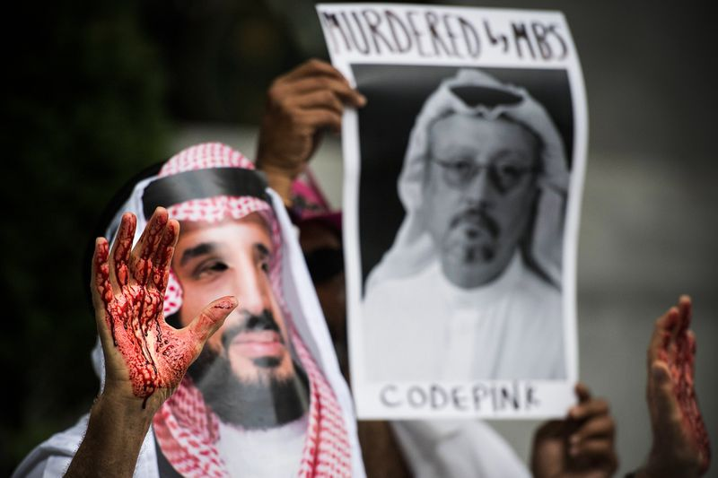 A demonstrator dressed as Saudi Arabian Crown Prince Mohammed bin Salman with blood on his hands protests outside the Saudi Embassy in Washington, DC, on October 8, 2018, demanding justice for missing Saudi journalist Jamal Khashoggi.
