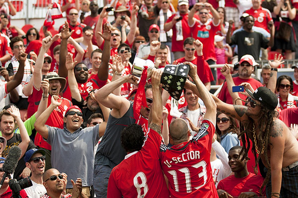 Reds fans with the V's Cup. by Giamou