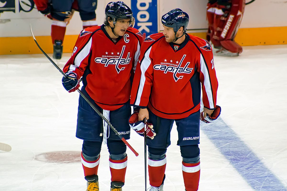 """Alex Ovechkin talks with his newest defenseman.  (Picture courtesy <a href=""""http://www.clydeorama.com/2011/11/caps-fall-flat-in-shootout/"""" target=""""new"""">Clydeorama</a>)"""